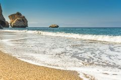 Waves wash over golden sand Stock Images