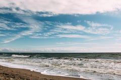 Sea and sky. Waves wash over sand on Black Sea beach Stock Image