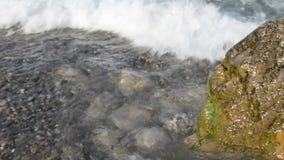 Waves washing big stone Stock Photo
