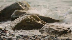 Waves washing gravel beach, beautiful Black Sea coast, relaxing trip to Georgia. Stock footage stock footage