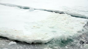 Waves washing over pack ice stock video footage