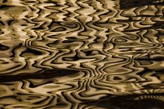 Waves on water create freakish diffractional structures similar. To velvet on its surface, yellow gold reflections on water organized into strict and chaotic stock photos