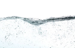 Waves of water with lots of bubbles,. Over white Royalty Free Stock Image