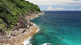 Waves water splash stone turquoise beach at view point andaman sea Koh Tachai Island stock video