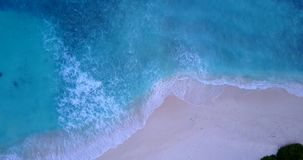 V11157 waves water texture breaking and crashing with drone aerial flying view of aqua blue and green clear sea ocean. Waves water texture breaking and crashing stock image