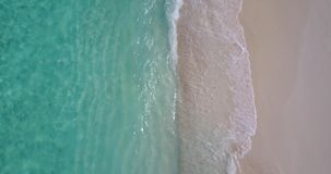 V11187 waves water texture breaking and crashing with drone aerial flying view of aqua blue and green clear sea ocean. Waves water texture breaking and crashing Royalty Free Stock Image
