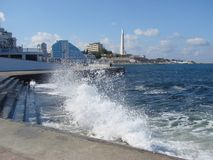 Waves on the waterfront. Of the Crimea in the early spring Royalty Free Stock Image