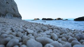Waves. And stones in Lefkada stock footage