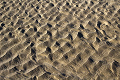Waves of wet sand Stock Photo