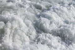 Waves with white foam of the sea Stock Images