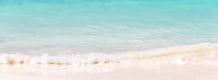 Waves on white sand and turquoise water, panoramic background. Waves on white sand and turquoise water, panoramic summer background Stock Photography