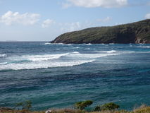 Waves on the windward side of bequia. Royalty Free Stock Photography