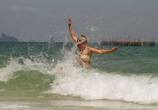 Waves. Woman hit by wave Stock Photo