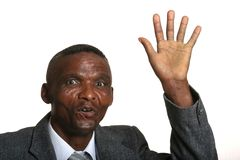Waving African businessman. Cheerful African business man waving his hand Royalty Free Stock Photography