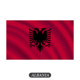 Waving Albania flag on a white background. Vector illustration. Waving  Albania flag on a white background. Vector illustration Stock Photo