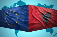Waving Albanian and European Union flags Stock Image