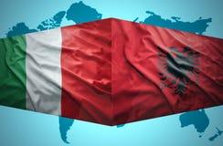 Waving Albanian and Italian flags Royalty Free Stock Photo