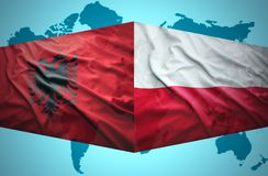 Waving Albanian and Polish flags Royalty Free Stock Photo