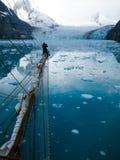 Waving from aloft on a tallship or sailboat Stock Photo