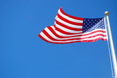 Waving america flag. An brand new America flag is against sky background Stock Photos