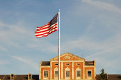 Waving american Flag. American flag waiving in the windf on a clear day over a government building Stock Photography