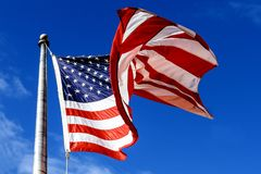 Waving american flag over the blue sky. USA Flag over blue sky waving american flag over the blue sky Royalty Free Stock Photography