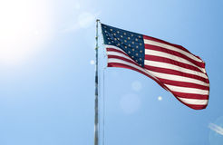 Waving American National Flag on Pole With Sunlight Effect Again Royalty Free Stock Photo
