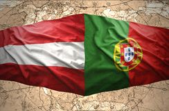 Austria and Portugal. Waving Austrian and Portuguese flags of the political map of the world Royalty Free Stock Image