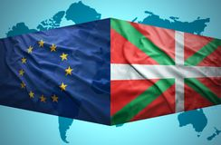 Waving Basque Country and European Union flags Royalty Free Stock Photos