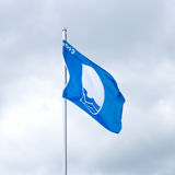 Waving blue flag Stock Photo