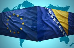 Waving Bosnian and European Union flags Royalty Free Stock Photos