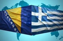 Waving Bosnian and Greek flags Royalty Free Stock Photos