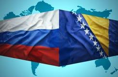 Waving Bosnian and Russian flags Stock Photos