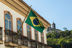 Waving Brazilian flag from a Colonial house in Ouro Preto, Brazil Royalty Free Stock Photos