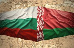 Bulgaria and Belarus. Waving Bulgarian and Belorussian flags of the political map of the world Royalty Free Stock Photos