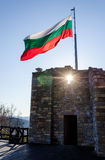 Waving bulgarian flag. Bulgarian flag waving over the ruins of Tzarevetz fortress in Veliko Tarnovo, Bulgaria Stock Photo