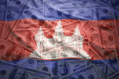 Waving cambodian flag on a american dollar money background Royalty Free Stock Image