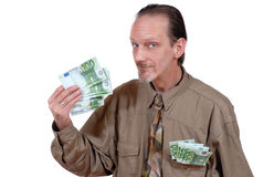 Waving with cash Stock Photo