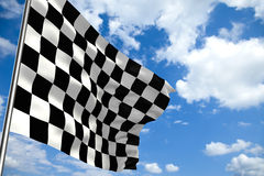 Waving checkered flag in front of a cloudy sky. High quality 3D render of waving checkered flag in front of a cloudy sky Royalty Free Stock Photos
