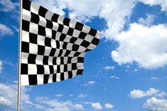 Waving checkered flag in front of a cloudy sky Stock Photography