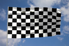 Waving checkered flag in front of a cloudy sky. High quality 3D render of a waving checkered flag in front of a cloudy sky Royalty Free Stock Photos