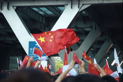 Waving Chinese flag. Chinese flag waving in crowd of happy people, who are waiting for olympic torch Royalty Free Stock Image