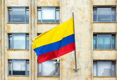 Waving Colombian Flag. Colombian flag waving in the wind in downtown Bogota, Colombia Royalty Free Stock Image