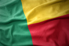 Waving colorful flag of benin. Royalty Free Stock Image