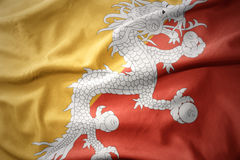 Waving colorful flag of bhutan. Royalty Free Stock Photography