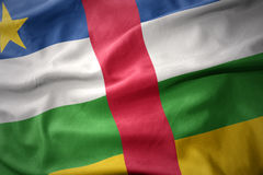 Waving colorful flag of central african republic. stock images
