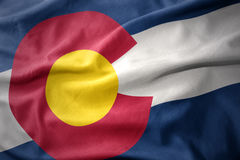 Waving colorful flag of colorado state. Waving colorful national flag of colorado state stock photography