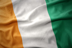 Waving colorful flag of cote d`ivoire. Waving colorful national flag of cote d`ivoire stock images
