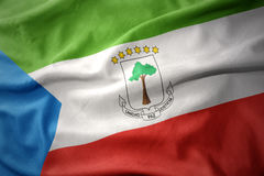 Waving colorful flag of equatorial guinea. Royalty Free Stock Images