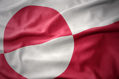 Waving colorful flag of greenland. Royalty Free Stock Photo